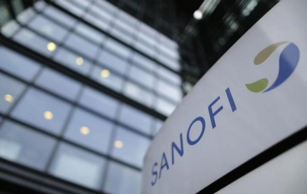 A logo is seen in front of the entrance at the headquarters of French drugmaker Sanofi in Paris